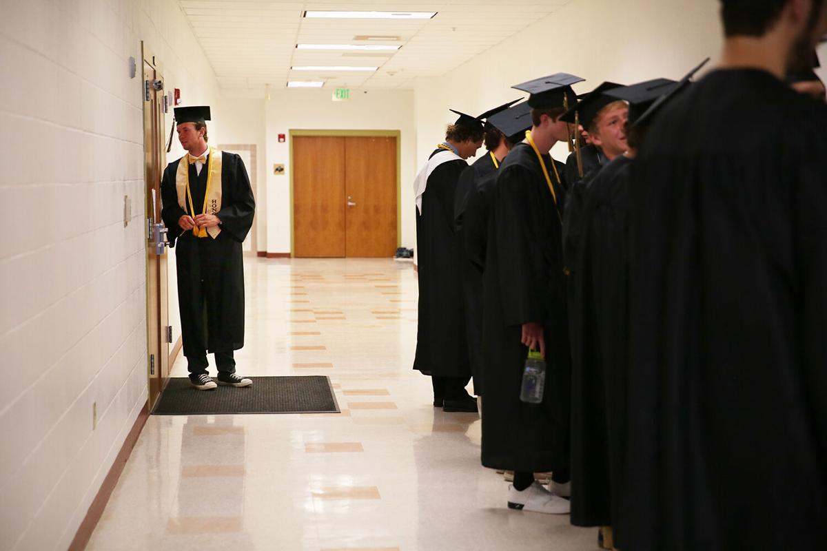 John Wonka peers through the gym doors as the class waits in line