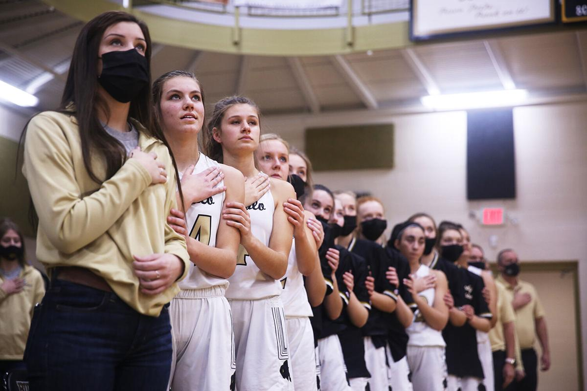 Buffalo High School's varsity girls team stands linked together
