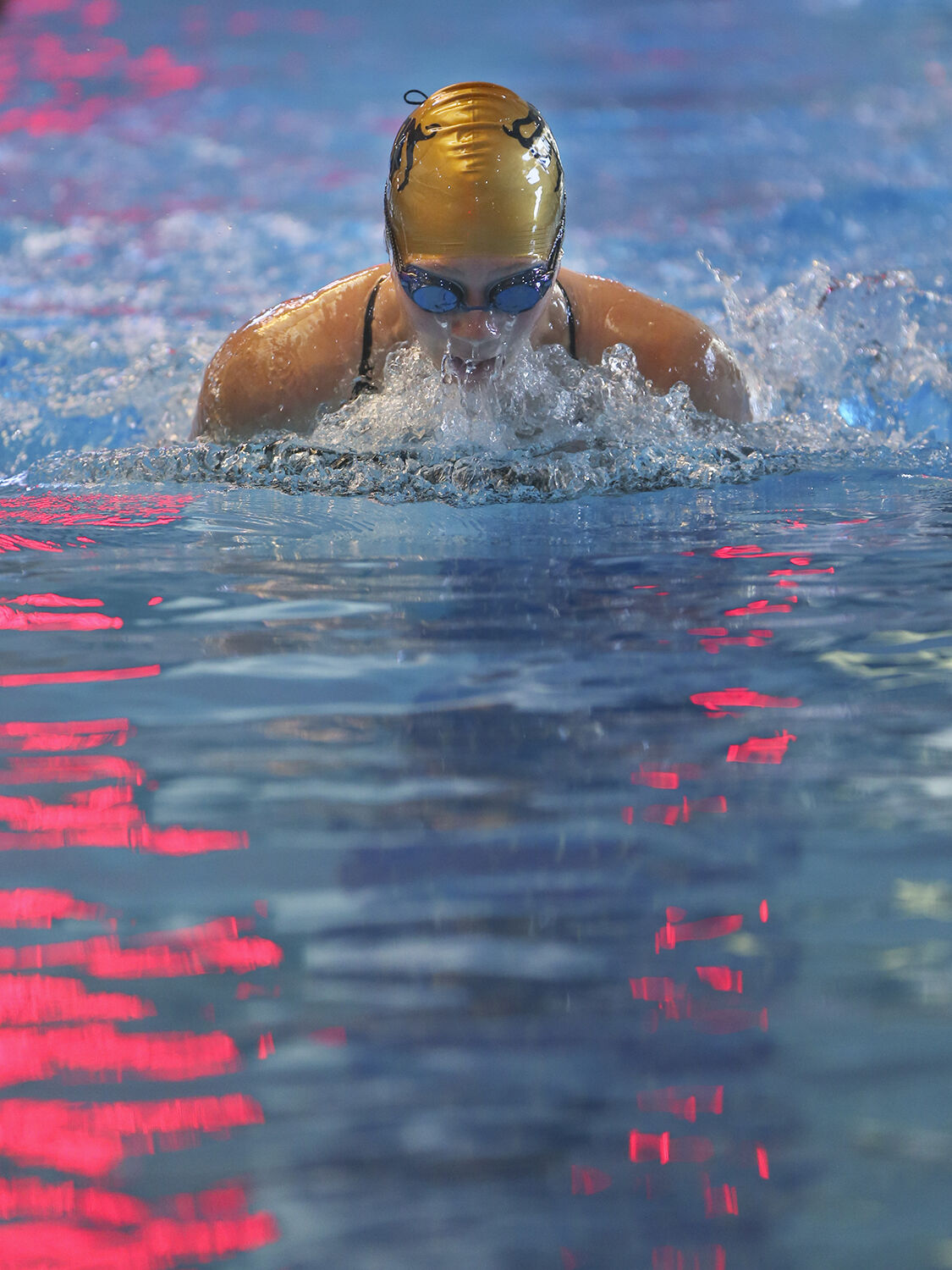 Makenna Lambert moves out of the water during her leg of the the 200 yard medley relay