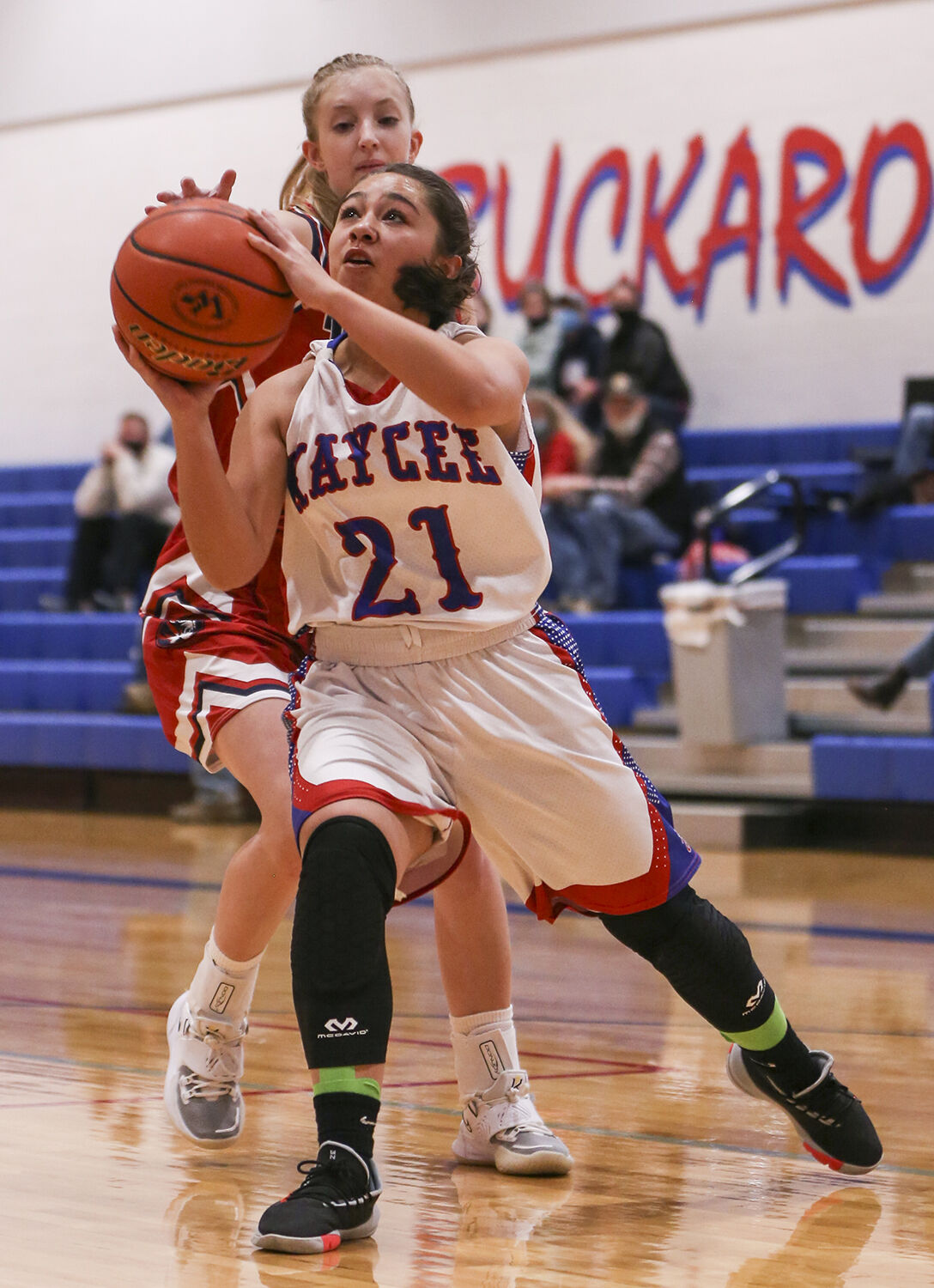 Mary Cleveland pushes away from a defender toward the basket
