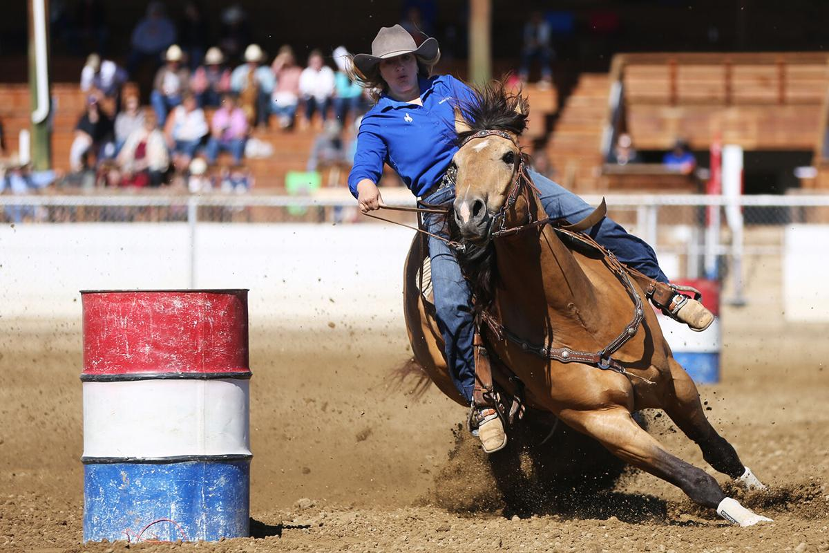 Isabelle Camino pulls around the first barrel during her barrel race