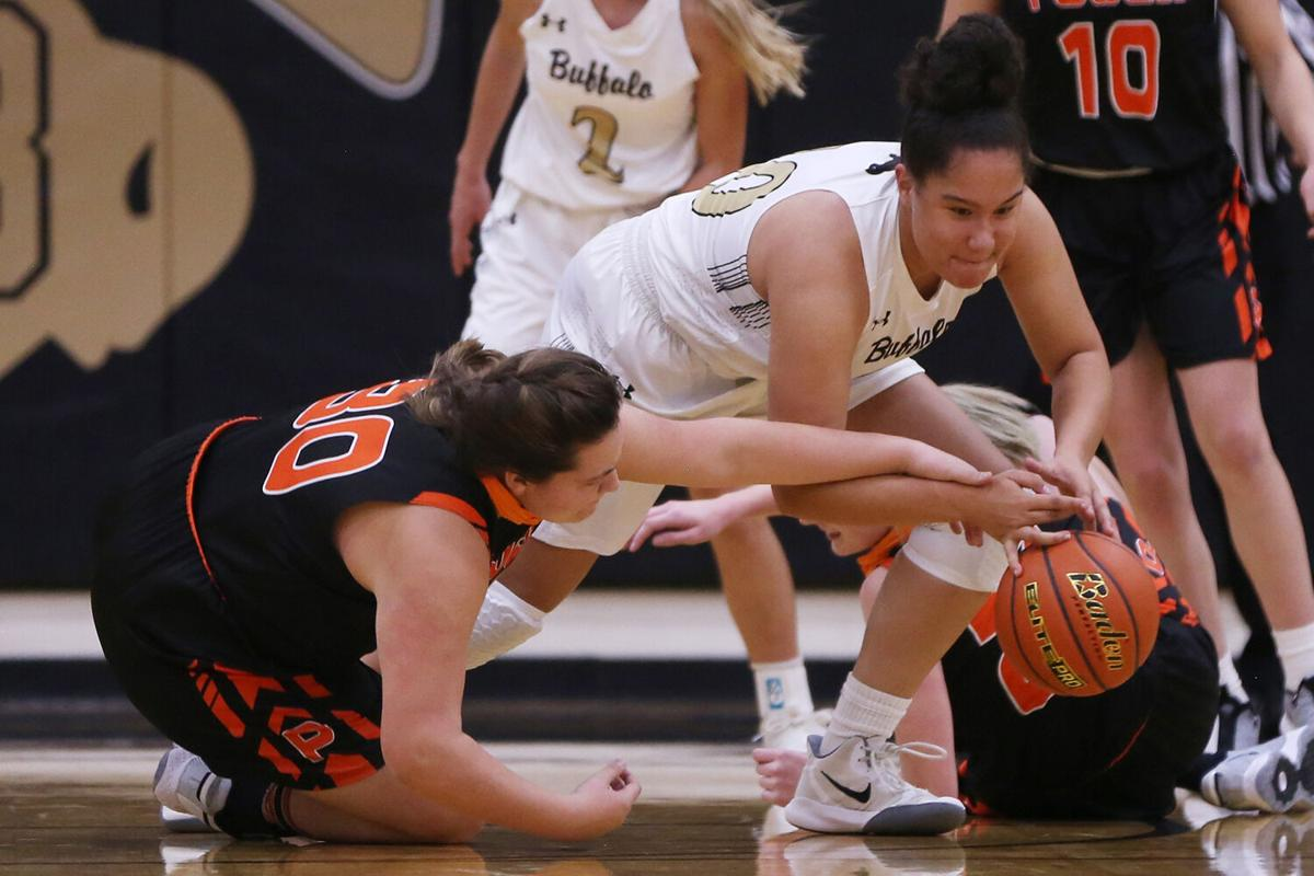 Danica Boyce dives to steal a ball from Powell senior Rylynn Valdez