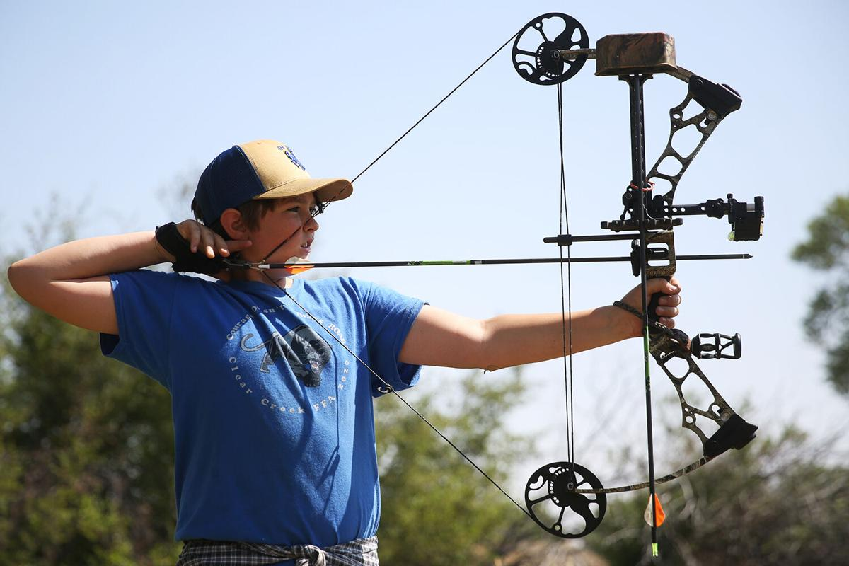 Wyatt Holland draws back his arrow during one of the early targets