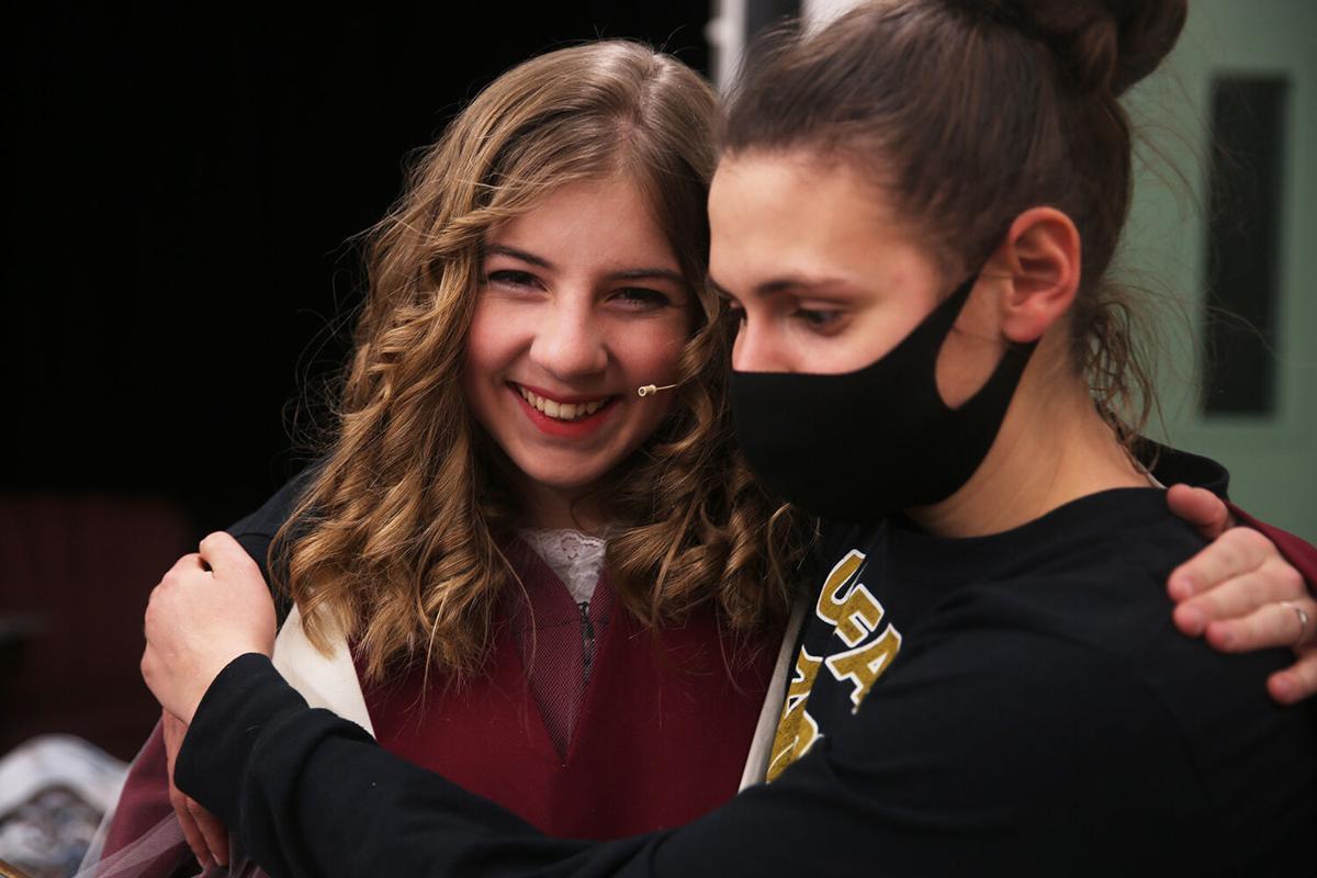 Laurel Rozema hugs angel Elizabeth Farris