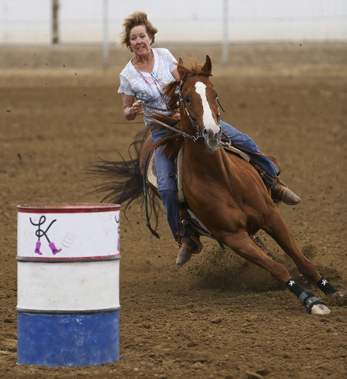 Mary Vroman looks for her turn around the first barrel during her run