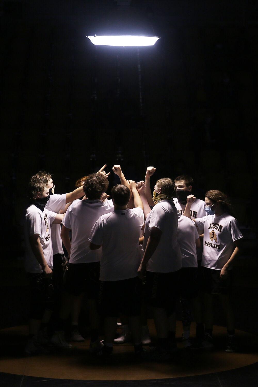 Buffalo High School's wrestling team huddles