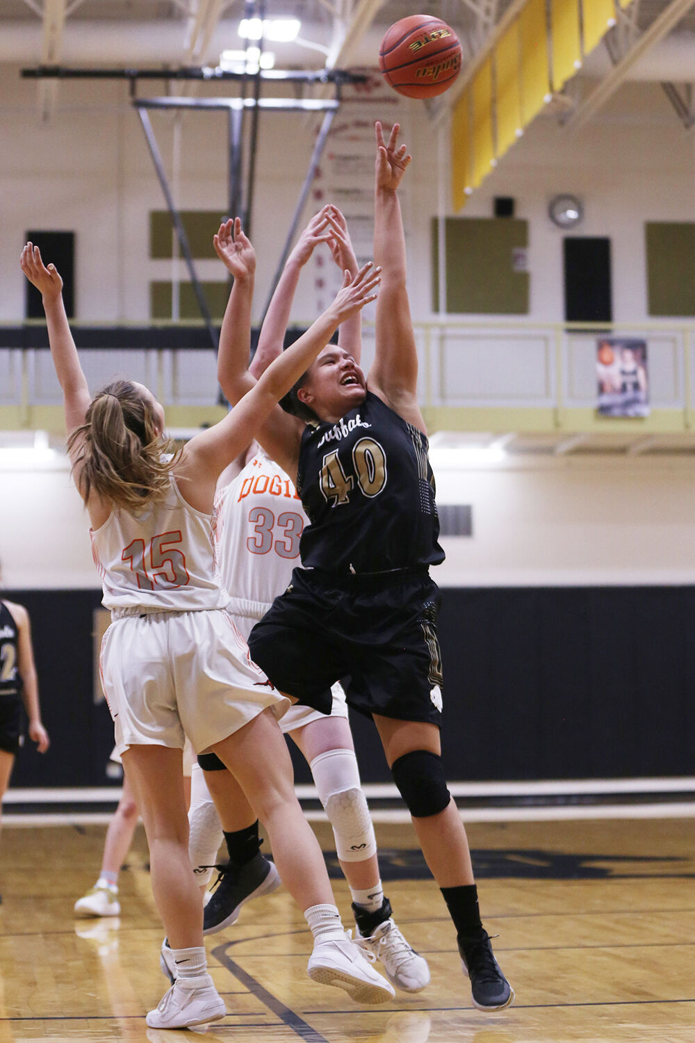 Danica Boyce jumps for two against Newcastle sophomore Hunter McFarland