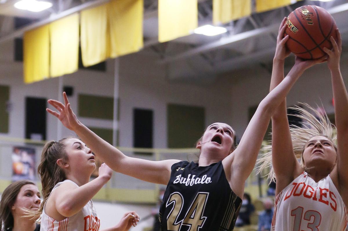 Cassidy Bessler stretches to steal a rebound