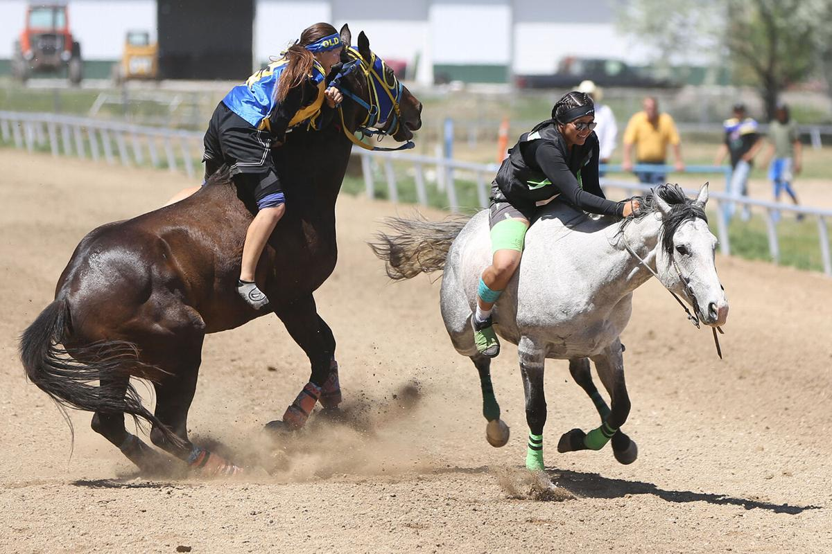 Kallie Washakie narrowly misses a collision with the rider
