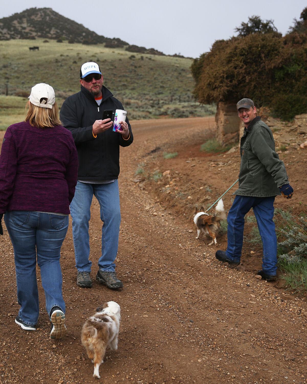 Bill Hawley walks backward to take photos