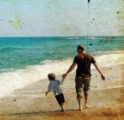 Father,And,Son,Playing,Together,On,The,Beach.,Photo,In