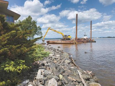 Rising water slams Lake Superior communities