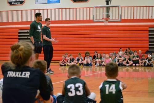 MSU basketball players talk to Manton kids