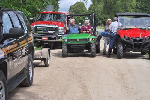 Neighbors scour woods with golf carts, ORVs looking for missing elderly woman