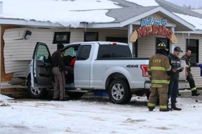 Injuries occur after pickup crashes into LeRoy restaurant