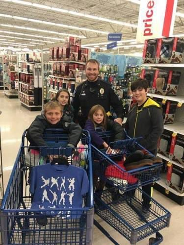 Officers help kids buy Christmas gifts for their families | News ...