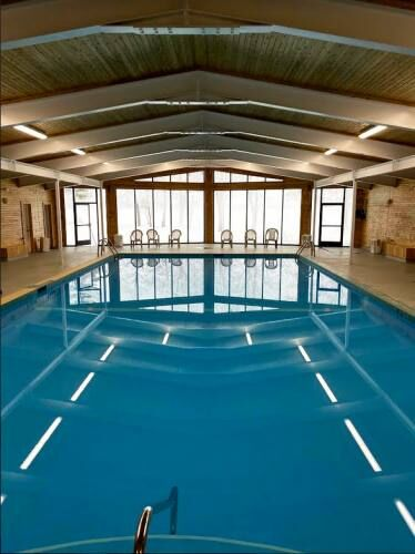Pool renovations at Lake Cadillac Resort include new roof, windows, 'rebuild' of attached rooms