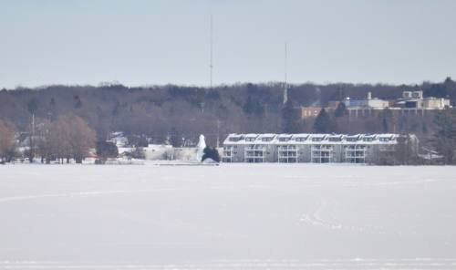 Growing Cadillac ice tree now visible from other side of the lake