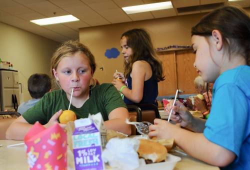Kickball, bugs, Spanish all part of YMCA day camp