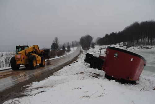 Icy roads almost send farm tractor into pond in Boon