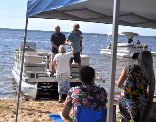 Bay City couple gets married on pontoon boat in Lake Mitchell