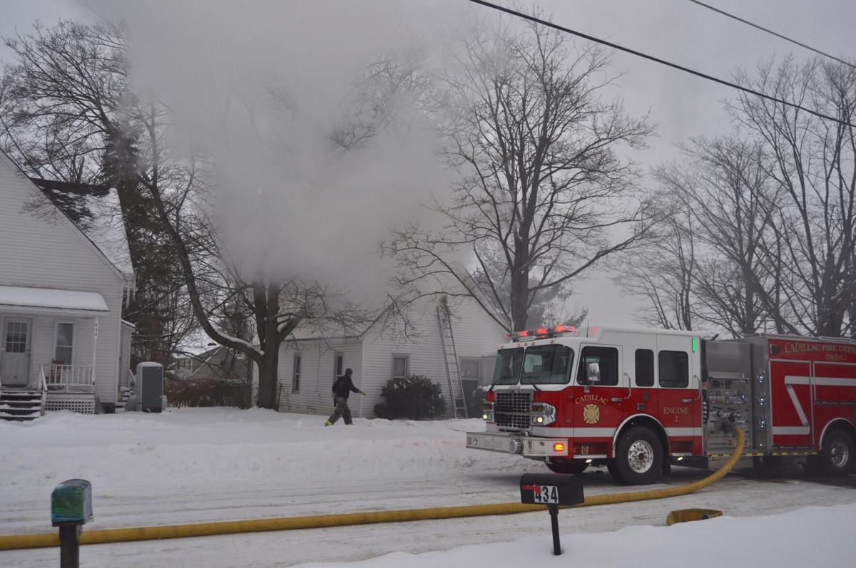 Firefighters battling blaze at Evart Street home, near Cadillac hospital