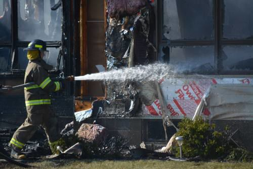 Pets lost in Manton garage fire; homeowners make it out safe