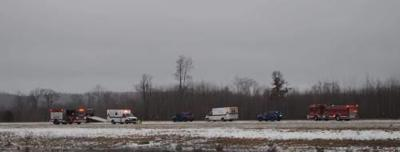 Rollover crash north of Cadillac sends 2 people to hospital