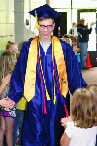 Cadillac seniors return to their elementary schools before graudation