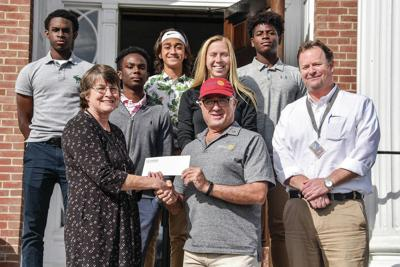 Lyndon Institute Students Present Check for Hurricane Relief Efforts