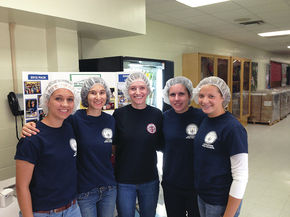 LHS students attend Feed My STarving Children MobilePackT event