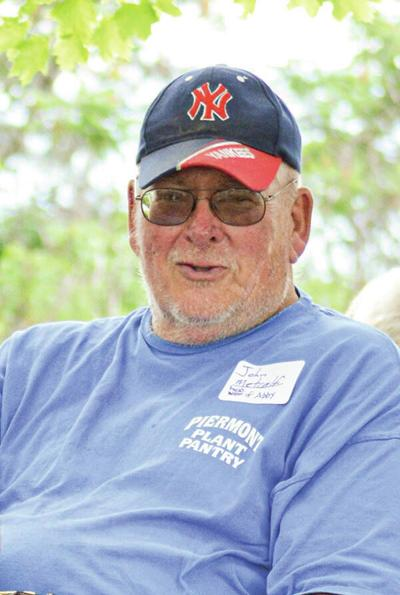 John E. Metcalf Obituary