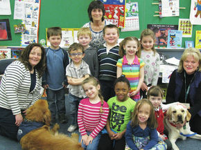 Therapy dogs visit Brighton Elementary students