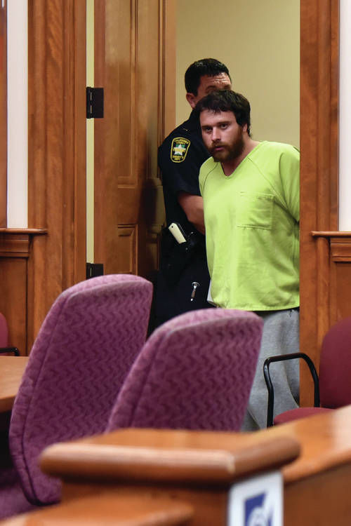 Furloughee Stands Accused Of Murder