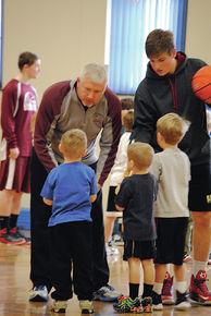 LI boys varsity coach works with young basketball hopefuls