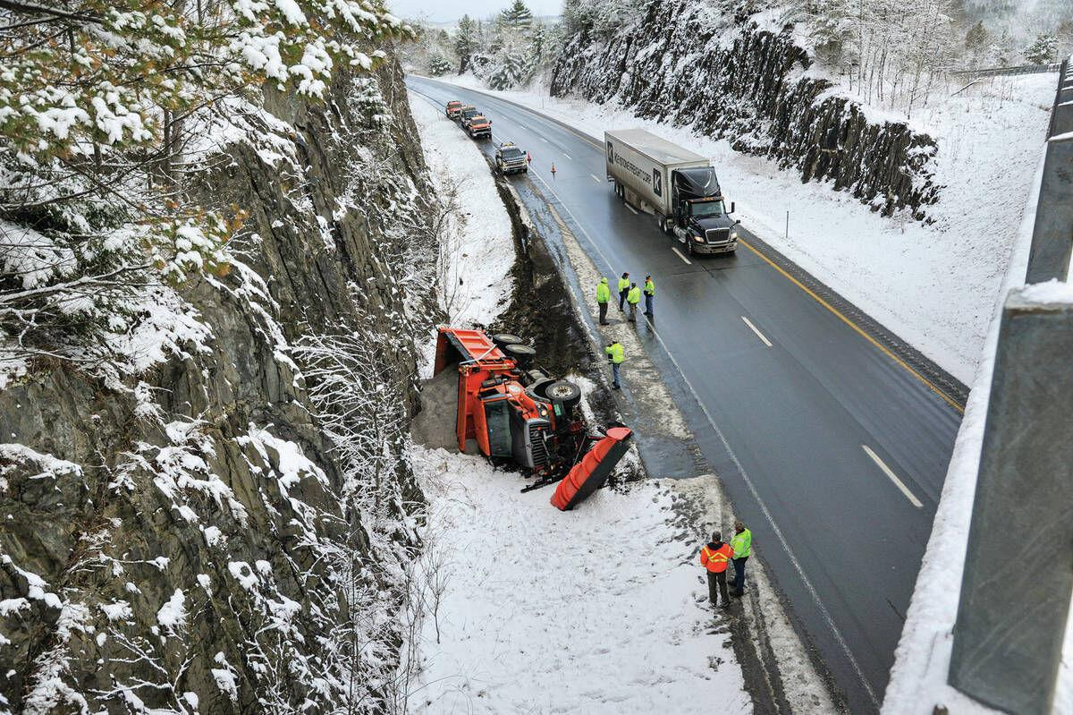 State Plow Truck Topples Off I91 While Dealing With Spring Snowfall