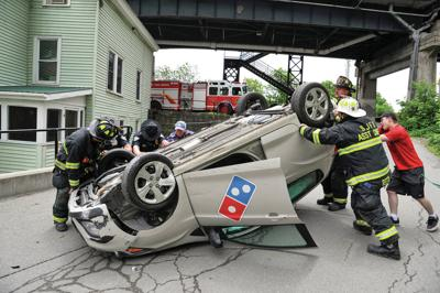 Pizza Delivery Car Flips On St. Mary Street