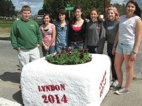 LI student decorate water trough in Lyndon Center