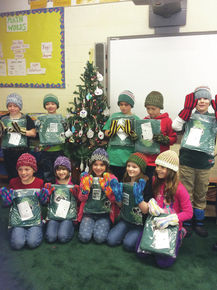 Lunenburg students receive new mittens and hats