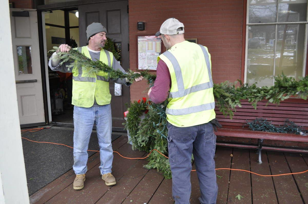 St. J Work Camp Helps Roll In Holiday Greenery