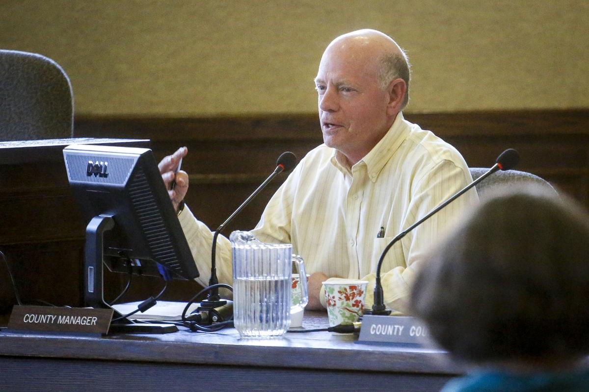County manager defends himself