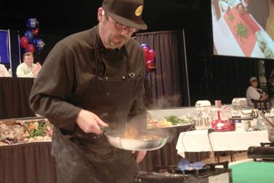 Hoffman sizzles with repeat Iron Chef title