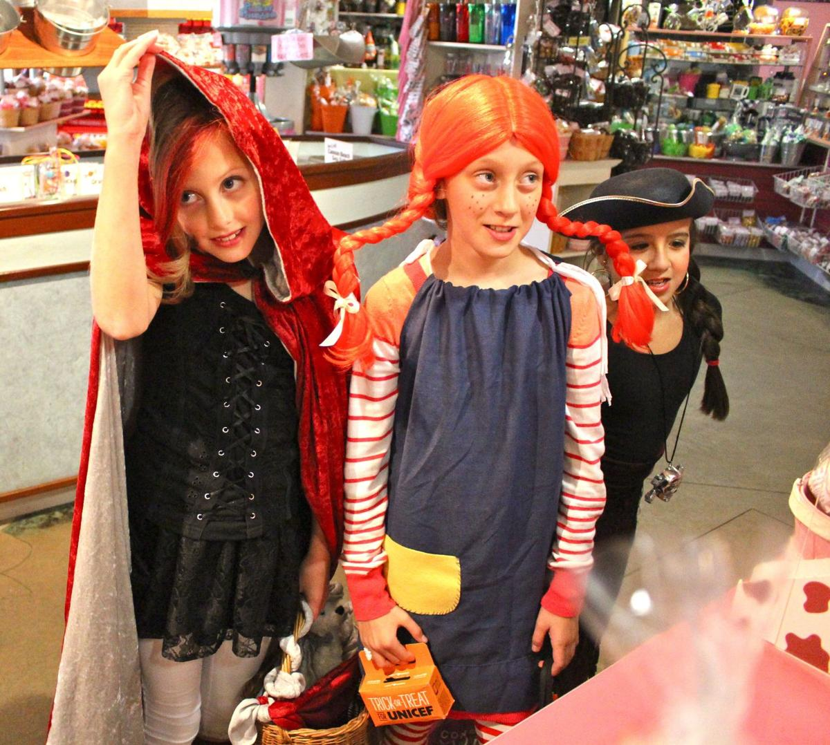 Trick-or-treaters flaunt their colorful costumes in downtown Cannon Beach