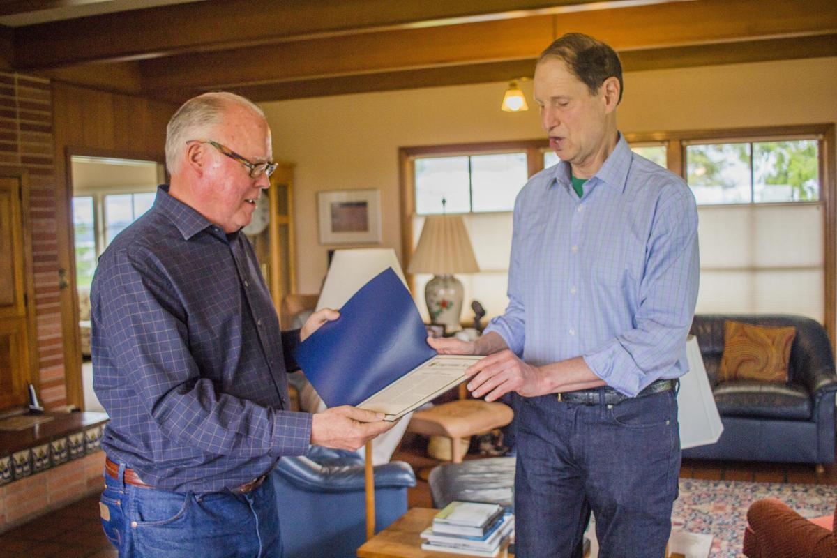 Wyden honors retired publisher