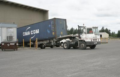 Truck hauling container