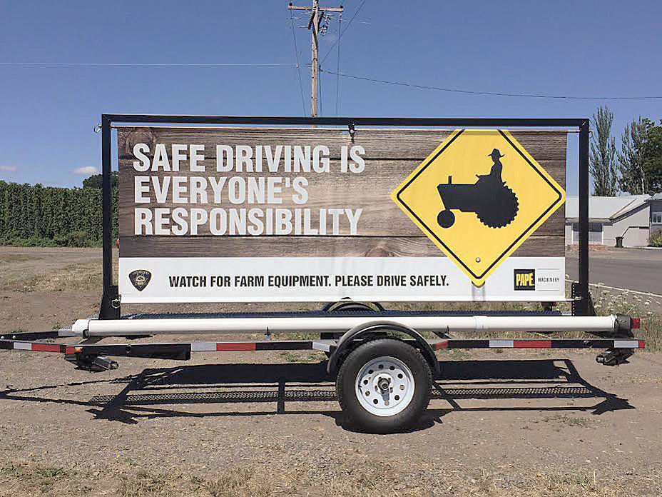 Signs urge drivers to keep it safe around farm machinery