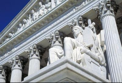 Feds urge against Supreme Court review of Hage dispute