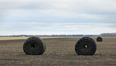 Farmer uses tiles to drain, and irrigate, field