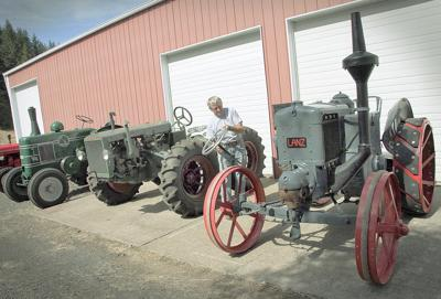 Antique tractor starts with a 'bang'