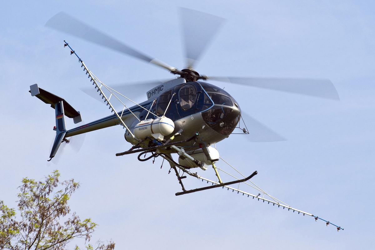 Oregon county's aerial spray ban gets day in court